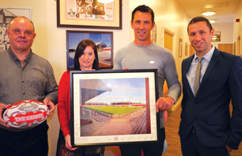 Group welcomes rugby legends to two of its homes