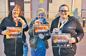 Staff walk on fire for residents