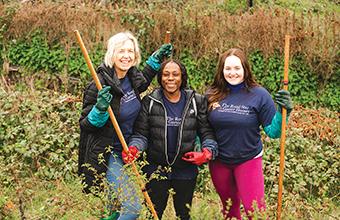 Charity staff and volunteers clean up stream